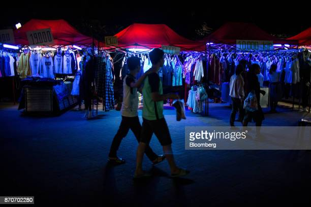 Shoppers walk past a night market along the river Mekong in Vientiane Laos on Thursday Nov 2 2017 Located in the Mekong region Southeast Asia's...