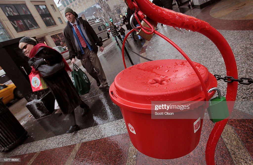 Shoppers walk past a Salvation Army kettle on December 21 2010 in Chicago Illinois As the season winds down donations to Chicago area kettles have...