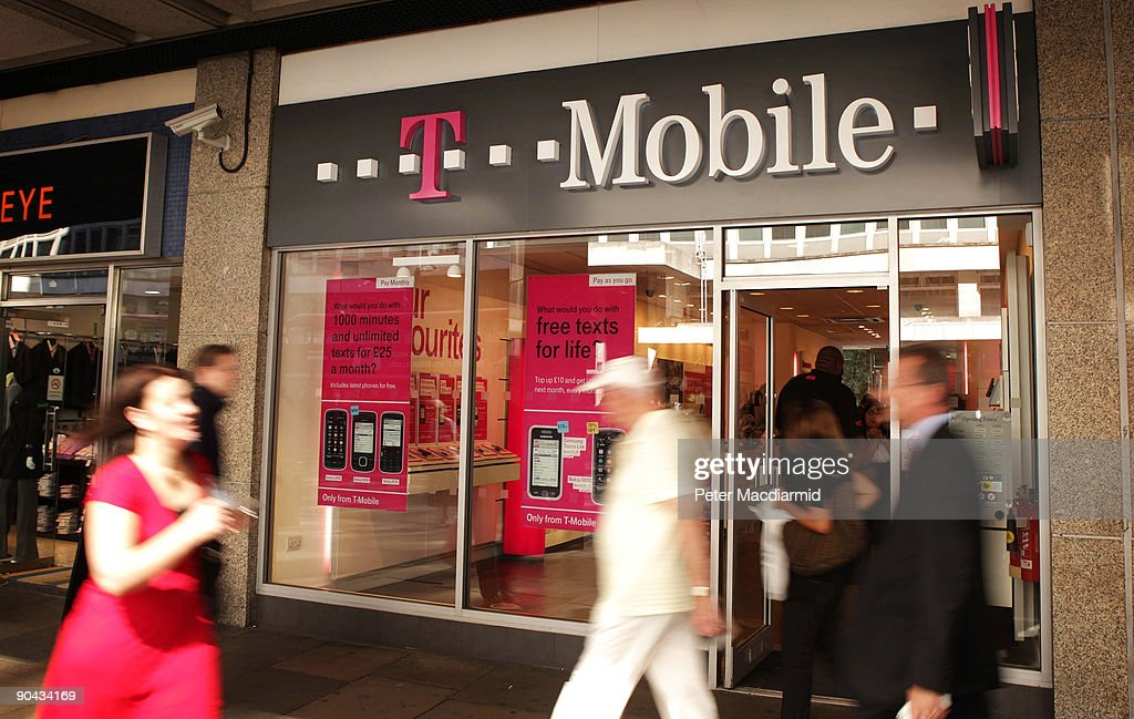 Shoppers walk past a T-Mobile shop in Victoria on September 8, 2009 in London, England. Mobile phone companies Orange and T-Mobile have anounced plans to merge their United Kingdom operations. This will create the UK's biggest mobile operator with a customer base of 28 million users.