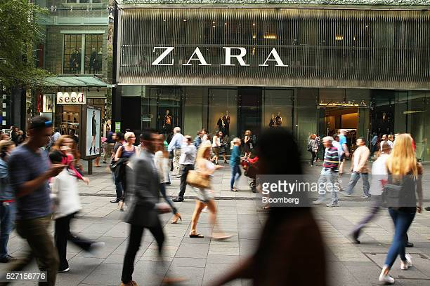 Shoppers walk past a Zara fashion store operated by Inditex SA at Pitt Street Mall in Sydney Australia on Friday April 29 2016 Australias drive to...