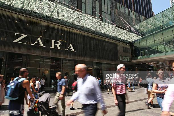 Shoppers walk past a Zara fashion store operated by Inditex SA at the Westfield Sydney shopping mall in Sydney Australia on Friday Feb 19 2016...