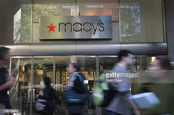 Shoppers walk past Macy's in the Magnificent Mile shopping district on August 14 2013 in Chicago Illinois Macys reported lower than expected second...