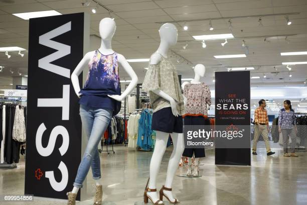 Shoppers walk past mannequins displayed at a Sears Canada Inc store inside a mall in Toronto Ontario Canada on Thursday June 22 2017 Canadian...