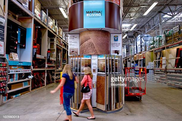 Shoppers walk past Martha Stewart Living carpet samples in a Home Depot store in Atlanta Georgia US on Monday June 28 2010 Home Depot Inc the world's...