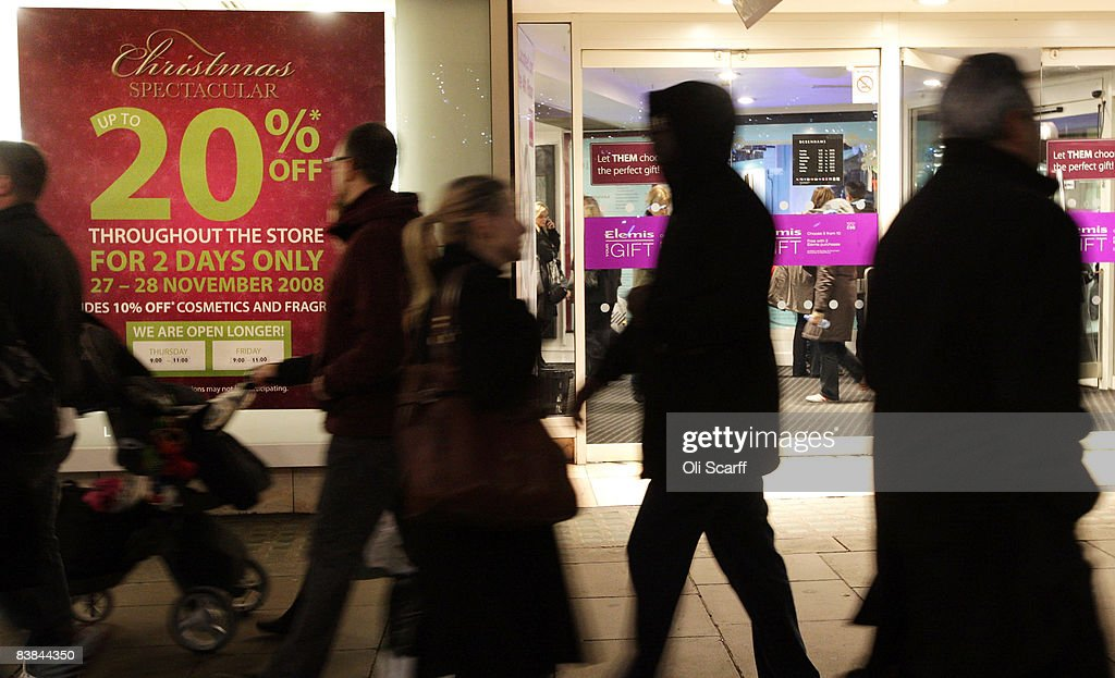 Shoppers walk past the Debenhams department store on Oxford Street on November 27, 2008 in London, England. The store is holding a two day 20% Off sale to entice Christmas shoppers during a difficult season for retailers as the global credit crisis begins to affect the high street.