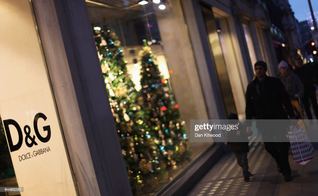 Shoppers walk past the Dolce & Gabbana store on New Bond Street on December 14, 2009 in London, England. High street stores are expecting a bumper Christmas this year despite the economic dowturn, with shoppers spending around GBP £120 million in the past two days alone.