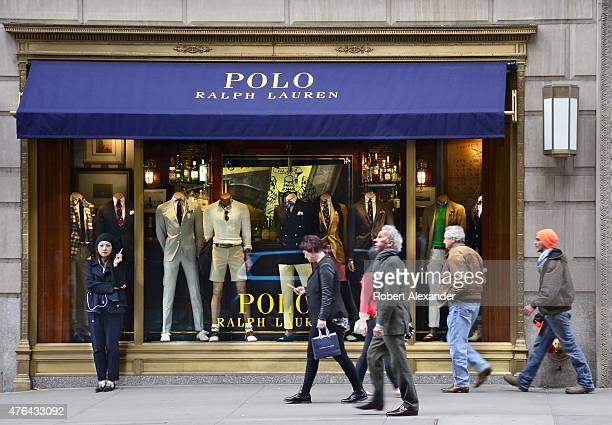 Shoppers walk past the entrance to the Polo Ralph Lauren clothing store on Fifth Avenue in Midtown Manhattan in New York City