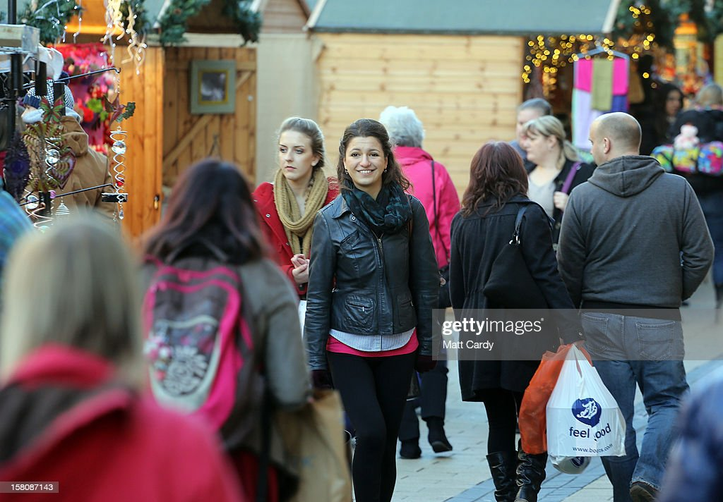 Shoppers walk through a Christmas market on December 10, 2012 in Bristol, England. With internet shopping still on the rise, many traditional retailers claim this Christmas could be the one that will determine the future of the high street.