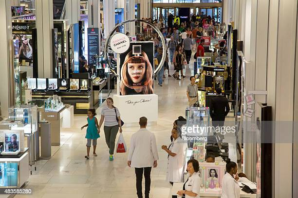 Shoppers walk through a Macy's Inc department store in New York US on Monday August 10 2015 Macy's Inc the largest US departmentstore company is...