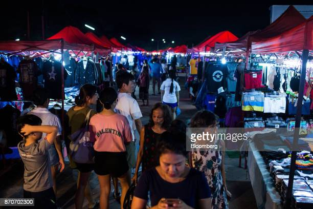 Shoppers walk through a night market along the river Mekong in Vientiane Laos on Thursday Nov 2 2017 Located in the Mekong region Southeast Asia's...