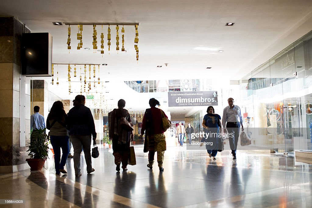 Shoppers walk through Ambience Mall in Gurgaon, India, on Wednesday, Nov. 21, 2012. Indian Prime Minister Manmohan Singh aims to spur spending on infrastructure to revive a faltering economy and tackle bottlenecks contributing to one of Asia's highest inflation rates. Photographer: Brent Lewin/Bloomberg via Getty Images