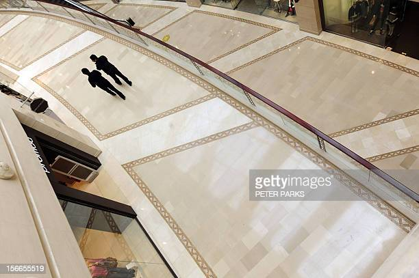 Shoppers walk through an empty shopping mall in Beijing on February 10 2009 Chinese inflation slowed further in January as activity in the world's...