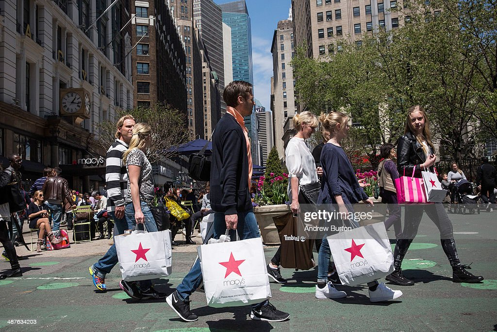 Shoppers walk through Herald Square outside Macy's on 34th Street on May 1 2014 in New York City Consumer spending rose sharply in the month of March...