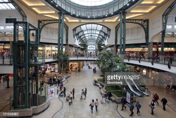 Shoppers walk through the CentrO retail complex in Oberhausen Germany on Tuesday Aug 16 2011 The German economy Europe's largest almost stalled in...