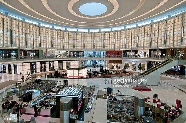 Shoppers walk through the Dubai Mall owned by Emaar Properties PJSC in Dubai United Arab Emirates on Tuesday Dec 8 2009 Debt restructuring by Dubai...