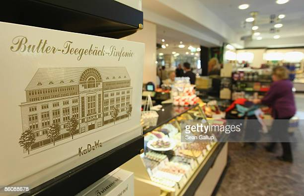 Shoppers walk through the food section at KaDeWe luxury department store on April 21 2009 in Berlin Germany German retail group Arcandor AG which...