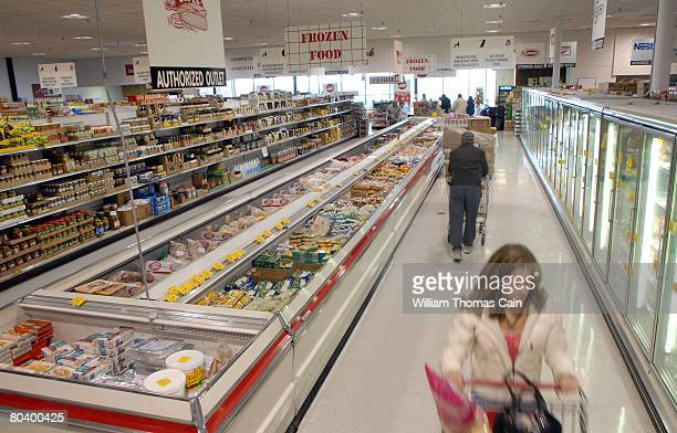 Shoppers walk through the frozen section at Amelia's Grocery Outlet a 'surplus' or 'salvage' grocer that buys manufacturers' closeouts March 27 2008...