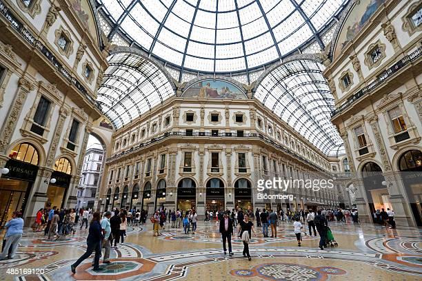 Shoppers walk through the Galleria Vittorio Emanuele shopping mall in Milan Italy on Monday Aug 24 2015 The Italian economy grew less than forecast...