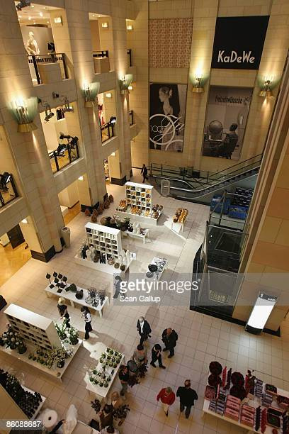 Shoppers walk through the KaDeWe luxury department store on April 21 2009 in Berlin Germany German retail group Arcandor AG which owns KaDeWe as well...
