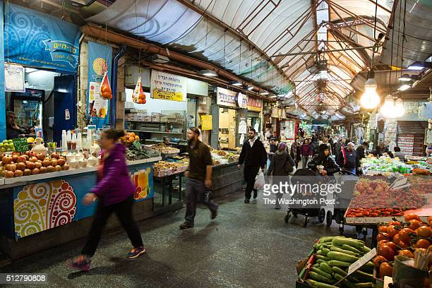 Shoppers walk through the Mahane Yehuda Market often called 'The Shuk' on February 24 in Jerusalem Israel For a story by William Booth and Ruth...
