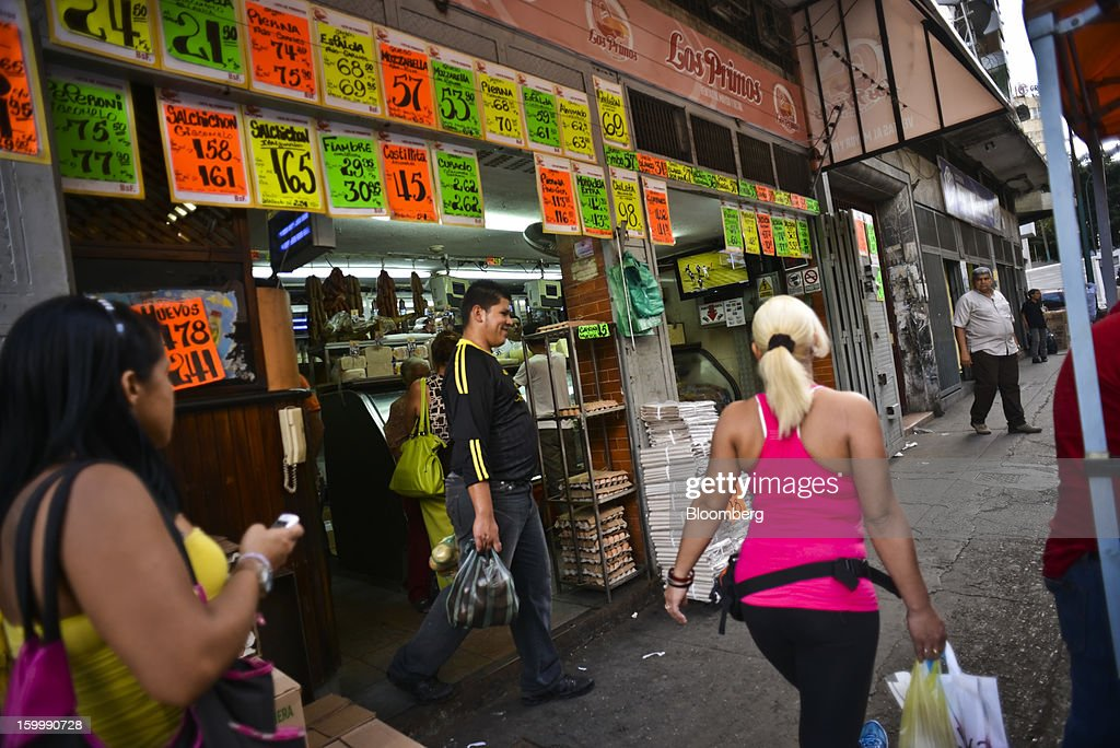 Shoppers walk through the Quinta Crespo market in central Caracas, Venezuela, on Monday, Jan. 14, 2013. The government is conducting a nationwide campaign to crack down on over-pricing and hoarding it blames for shortages of basic goods, from toilet paper to sugar. Photographer: Meridith Kohut/Bloomberg via Getty Images