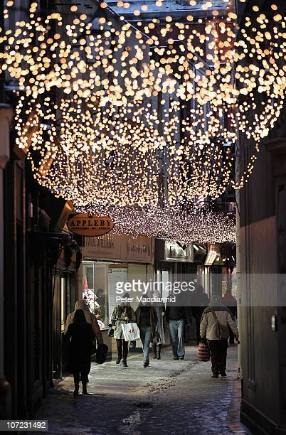Shoppers walk under Christmas lights near Grafton Street on December 1 2010 in Dublin Ireland The Irish economy has faltered after years of growth...