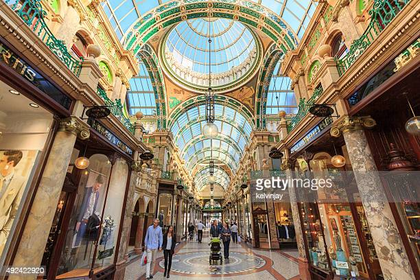 Shoppers walking through County Arcade in Leeds, West Yorkshire