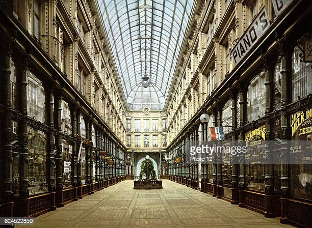 Shopping Arcade in Rotterdam Holland _Shops lining both sides of glassroofed arcade Netherlands_City Trade Retail
