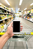 Shopping at the supermarked with smart phone