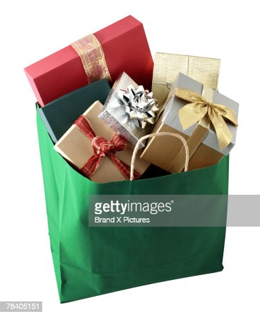 Shopping Bag Full Of Gifts Stock Photo | Getty Images
