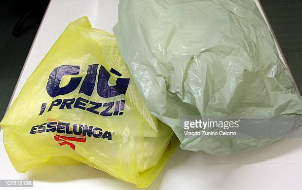 A shopping bag in virgin polyethylene and a traditional plastic bag are displayed on December 30 2010 in Milan Italy Virgin polyethylene shopping...