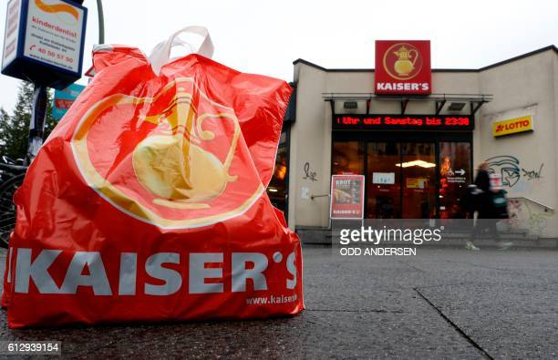 A shopping bag of German retail chain Kaiser's Tengelmann stands in front of a Kaiser's supermarket in Berlin on October 6 2016 A high level meeting...