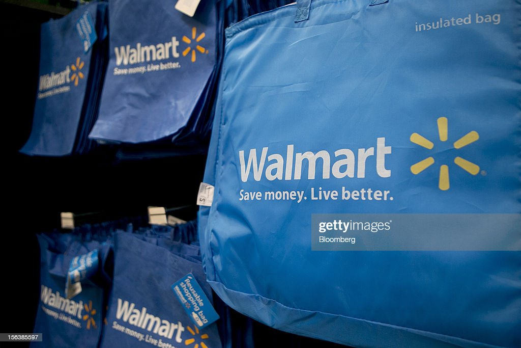Shopping bags for sale hang on display at a Wal-Mart store in Alexandria, Virginia, U.S., on Wednesday, Nov. 14, 2012. Wal-Mart Stores Inc. is scheduled to release earnings data on Nov. 15. Photographer: Andrew Harrer/Bloomberg via Getty Images