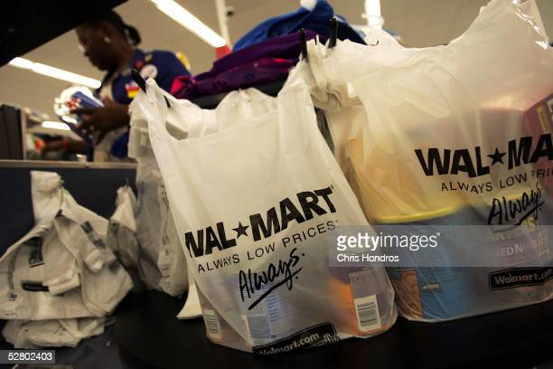Shopping bags lie on a checkout counter of a WalMart Supercenter May 11 2005 in Troy Ohio WalMart America's largest retailer and the largest company...