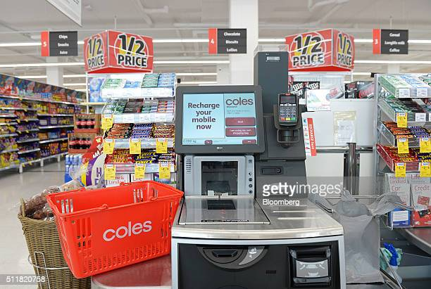 A shopping basket is arranged for a photograph next to a self checkout counter in a Coles supermarket operated by Wesfarmers Ltd in Melbourne...