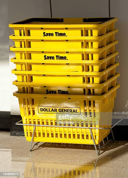 Shopping baskets are stacked inside a Dollar General Corp store in Saddle Brook New Jersey US on Saturday Dec 3 2011 Dollar General is scheduled to...
