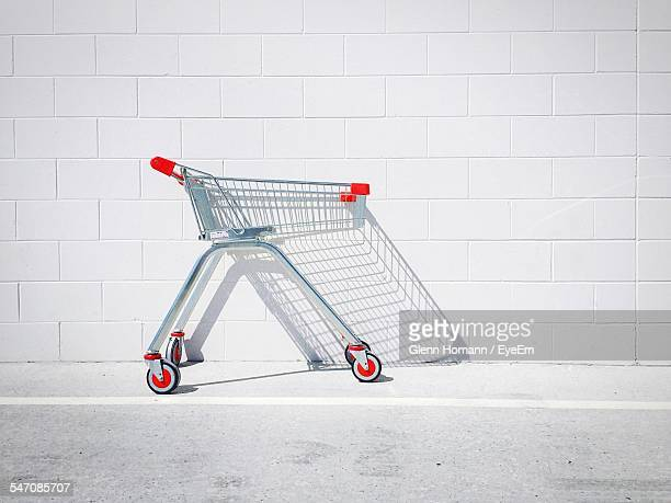 Shopping Cart Against White Wall
