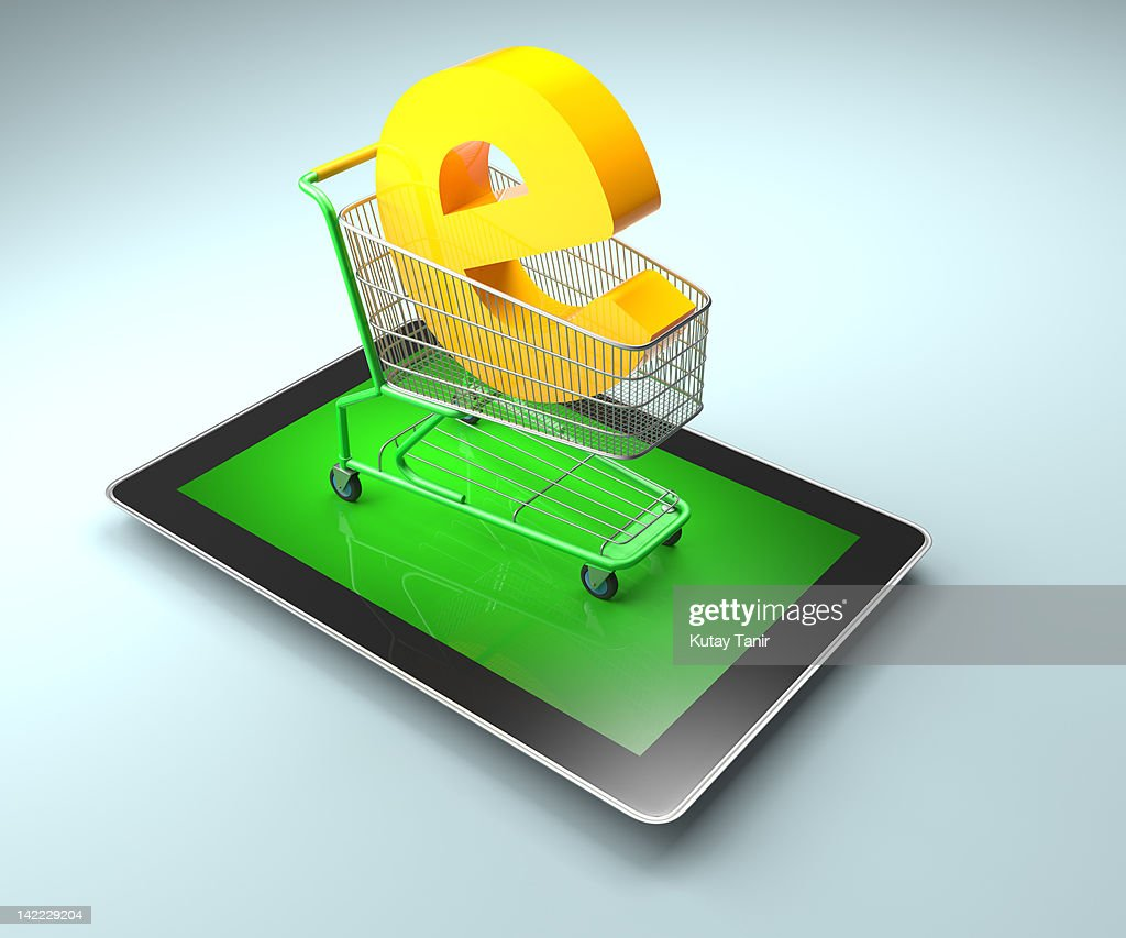Shopping cart and letter 'e' on a digital tablet. : Foto stock