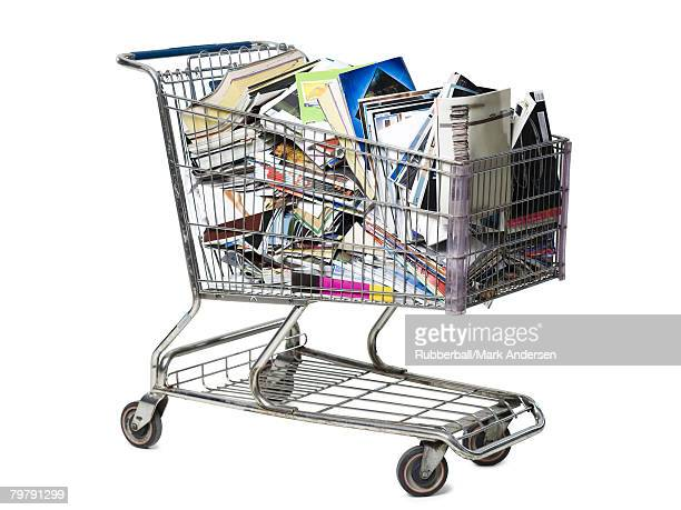 Shopping cart filled with books and magazines