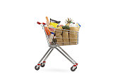 Shopping cart filled with groceries isolated on white background