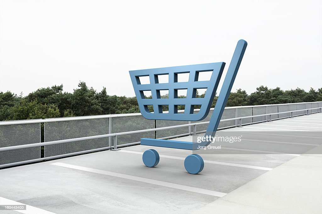 Shopping cart icon in car park : Stock Photo