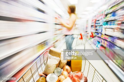 Shopping cart in store with motion blur