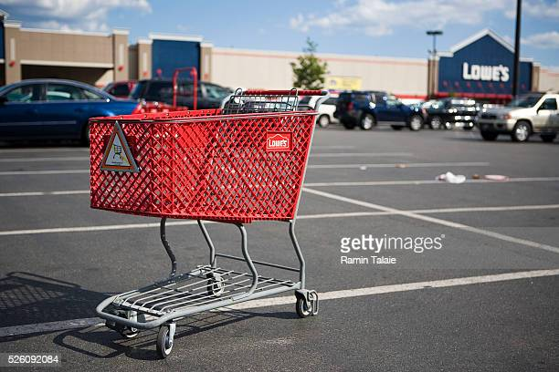 A shopping cart in the parking lot of a Lowe's store in Brooklyn New York Profits for Lowe's the secondlargest homeimprovement retailer fell for the...
