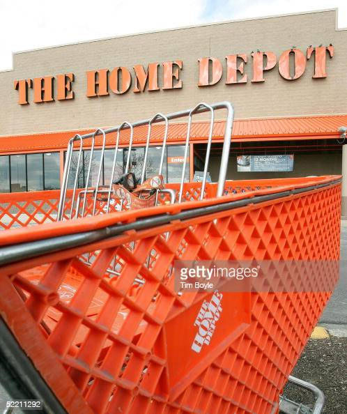 A shopping cart is seen outside The Home Depot store February 17 2005 in Evanston Illinois The world's largest home improvement retailer Atlantabased...