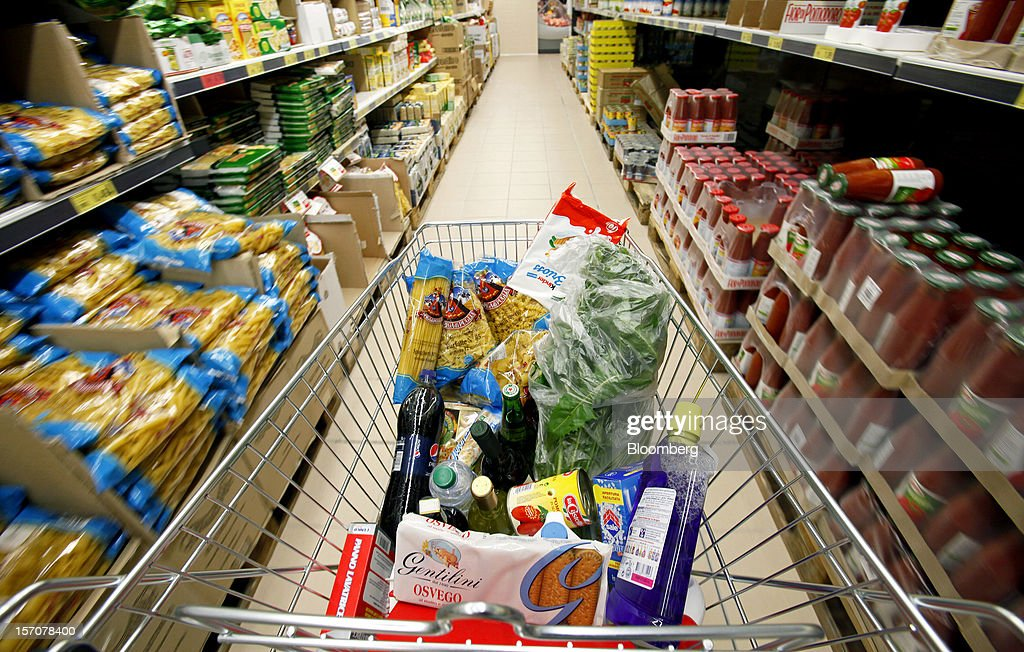 A shopping cart loaded with groceries is pushed along the aisle of a OnePrice supermarket, operated by Gruppo BSE, in this arranged photograph in Monterotondo, Italy, on Wednesday, Nov. 28, 2012. Italy needs to uphold Prime Minister Mario Monti's pledge to shore up public finances in order to enjoy investor confidence even after elections due by April, the Organization for Economic Cooperation and Development said in its latest Economic Outlook report this week. Photographer: Alessia Pierdomenico/Bloomberg via Getty Images