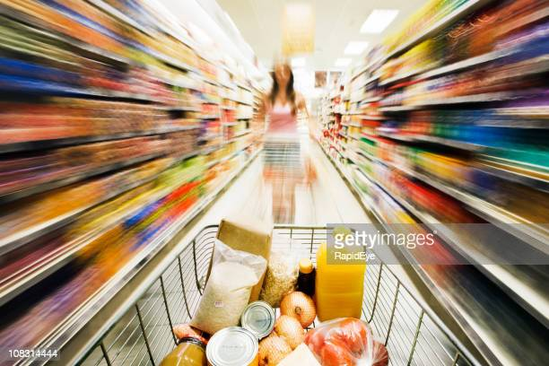 Shopping cart races through store with rainbow motion blur surrounding
