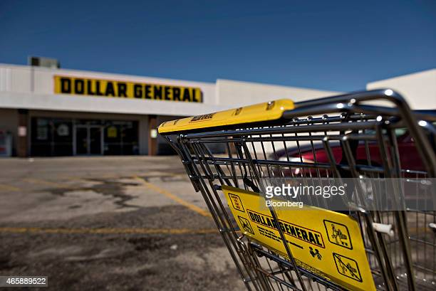 A shopping cart sits in a parking lot outside a Dollar General Corp store in Moline Illinois US on Wednesday March 11 2015 Dollar General Corp is...