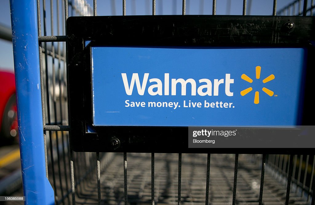 A shopping cart sits in the parking lot of a Wal-Mart store in Alexandria, Virginia, U.S., on Wednesday, Nov. 14, 2012. Wal-Mart Stores Inc. is scheduled to release earnings data on Nov. 15. Photographer: Andrew Harrer/Bloomberg via Getty Images