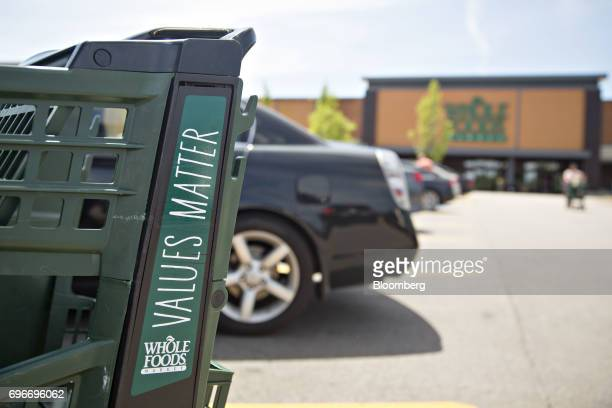 A shopping cart sits outside a Whole Foods Market Inc location in Willowbrook Illinois US on Friday June 16 2017 Amazoncom Inc will acquire Whole...