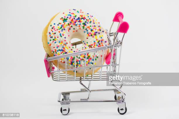 Shopping cart with a colorful donut